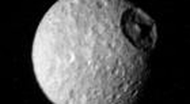 The cratered surface Saturn's moon Mimas is seen in this image taken NASA's Voyager 1 on Nov. 12, 1980 from a range of 425,000 kilometers (264,000 miles).