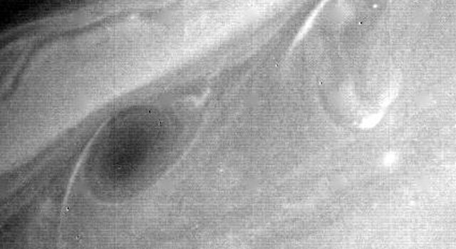Further details of Saturn's atmosphere are evident in this photograph, a black-and-white print of a green-filter frame taken Aug. 21 by NASA's Voyager 2.
