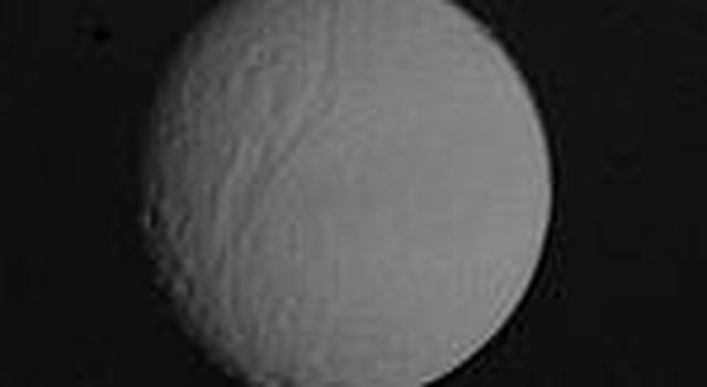 The heavily cratered surface of Tethys was photographed at l:35 a.m. PST on November 12 from a distance of l.2 million kilometers (750,000 miles) NASA's by Voyager l.