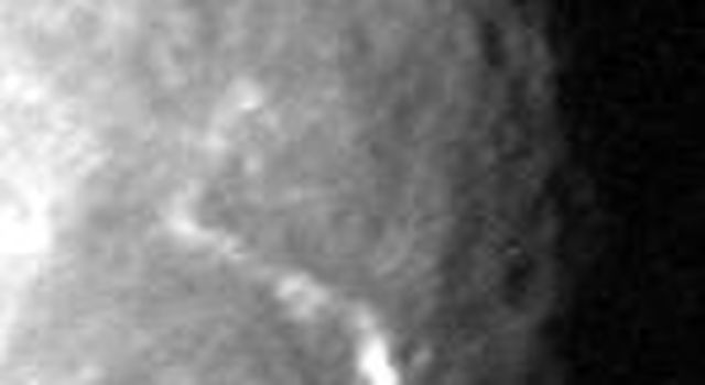 The terminator region of Titania, one of Uranus' five large moons, was captured in this Voyager 2 image obtained in the early morning hours of Jan. 24, 1986.