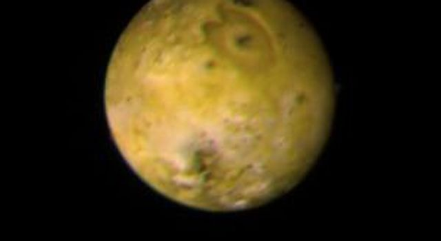 The trailing face of Jupiter's inner satellite Io is shown in this photo taken by NASA's Voyager 1 on March 3, 1979, from a distance of 1.7 million miles.