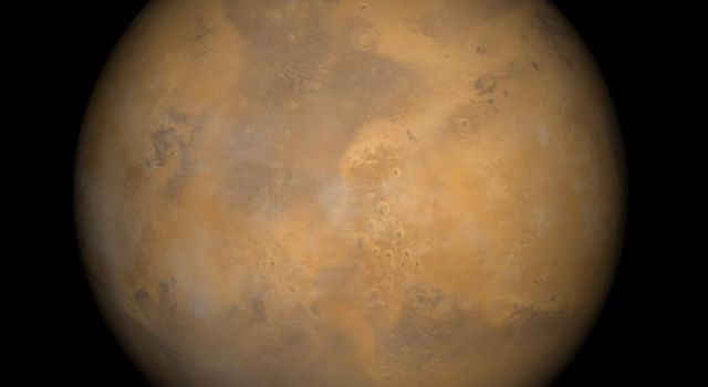 NASA's Mars Global Surveyor's view of the red planet Mars shows the region that includes Ares Vallis and the Chryse Plains and the north polar cap.