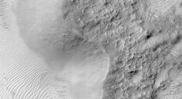 NASA's Viking Orbiter picture, on left, shows the crater, Escalante. The right shows the same area from NASA's Mars Global Surveyor. Both show a crater wall that is relatively smooth.