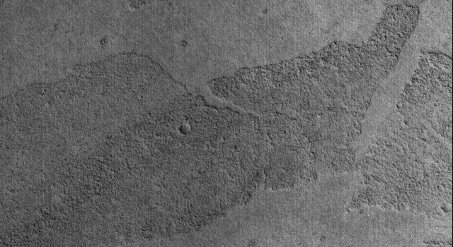 NASA's Mars Global Surveyor captured the platy flow surfaces in the Marte Vallis region of Mars on March 20, 2006.