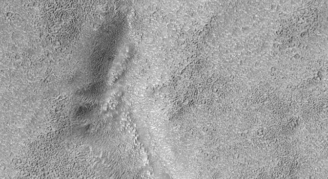 NASA's Mars Global Surveyor shows Warrego Valles, a system of discontinuous valleys located in the martian southern hemisphere south of Valles Marineris between Aonia Terra and Icaria Planum.