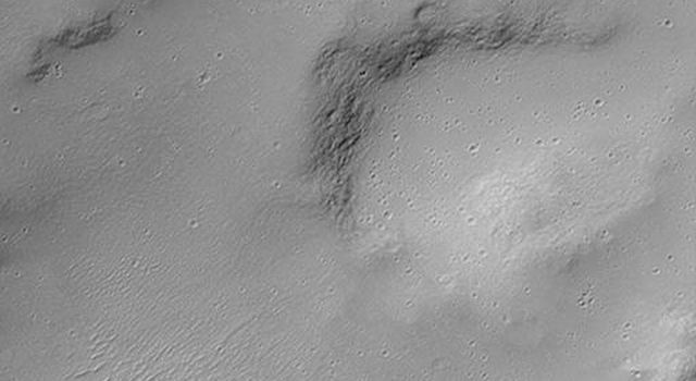 NASA's Mars Global Surveyor shows a crater found on Hesperia Planum on Mars. This crater was formed by the impact and explosion of a meteorite at some time in the martian past.