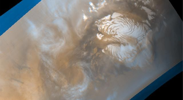 NASA's Mars Global Surveyor shows mid-summer in the northern hemisphere of Mars, a time of enhanced heating that leads to the release of water vapor into the atmosphere.