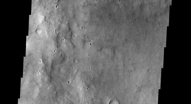 This crater and its interesting floor features is located south of Meridiani Terra on Mars as seen by NASA's 2001 Mars Odyssey.