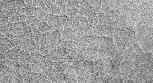 NASA's Mars Global Surveyor shows the floor of an old impact crater on the northern plains of Mars. Each 'tile' is somewhat larger than a football field.