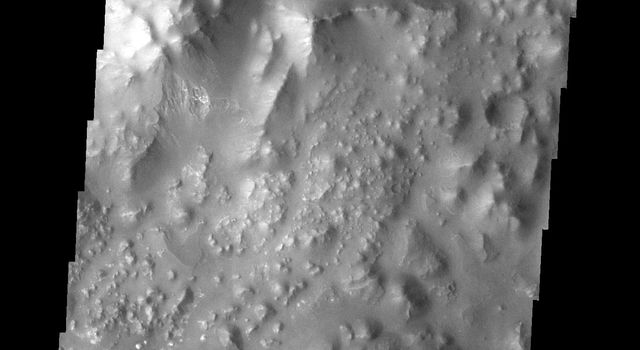 This type of 'broken-up' terrain on Mars is called chaos as seen by NASA's 2001 Mars Odyssey spacecraft.