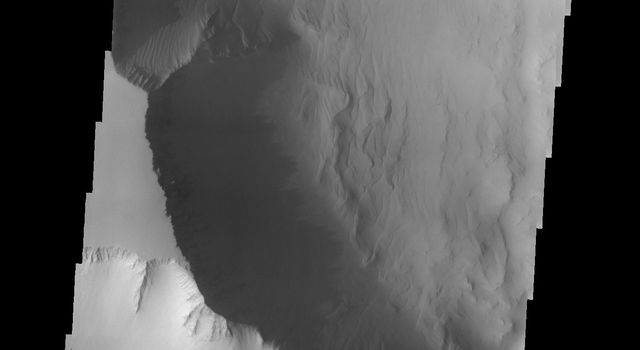This dust avalanche is located in part of Noctis Labyrinthus on Mars as seen by NASA's 2001 Mars Odyssey spacecraft.