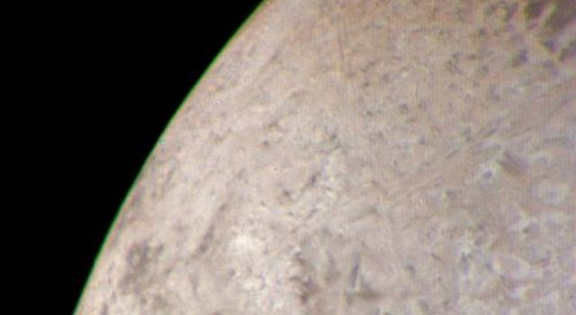 This natural color image of the limb of Triton was taken early in the morning of Aug. 25 1989, when the Voyager 2 spacecraft was at a distance of about 210,000 kilometers (128,000 miles) from the icy satellite.