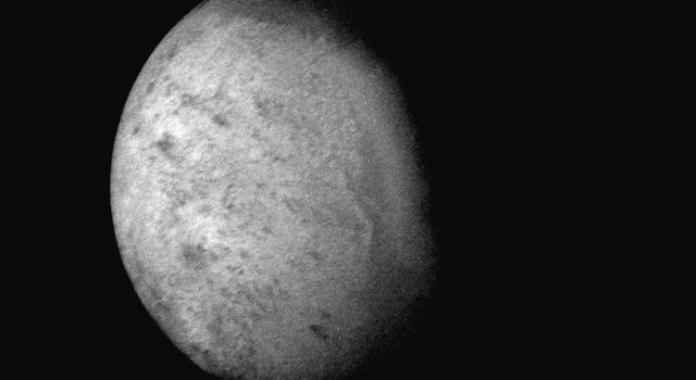 NASA's Voyager 2 was 530,000 kilometers (330,000 miles) from Neptune's largest satellite, Triton, when this photo was taken, Aug. 24, 1989. This is the first photo of Triton to reveal surface topography.
