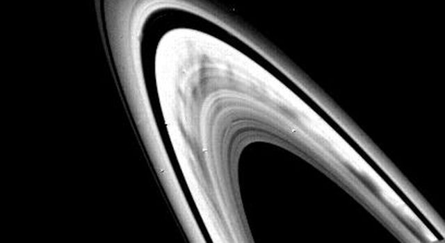 Prominent dark spokes are visible in the outer half of Saturn's broad B-ring in this NASA Voyager 2 photograph taken on Aug. 3, 1981 from a range of about 22 million kilometers (14 million miles).