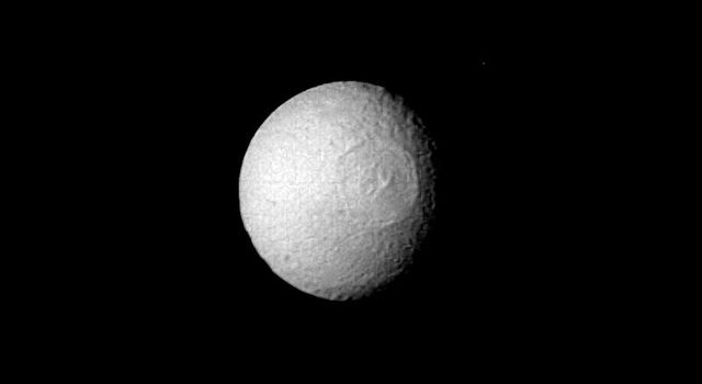 The Saturn satellite Tethys was viewed by NASA's Voyager 2 on Aug. 25 from a distance of 1 million kilometers (620,000 mi.).