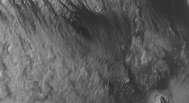 This image from NASA's Mars Global Surveyor shows gullies formed in the wall of a depression located on the floor of Rabe Crater west of the giant impact basin, Hellas Planitia on Mars.
