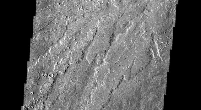 These lava flows are part of the Arsia Mons complex on Mars as seen by NASA's 2001 Mars Odyssey spacecraft.