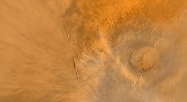 NASA's Mars Global Surveyor shows Arsia Mons, one of the largest volcanoes known on Mars. This shield volcano is part of an aligned trio known as the Tharsis Montes, the others are Pavonis Mons and Ascraeus Mons.