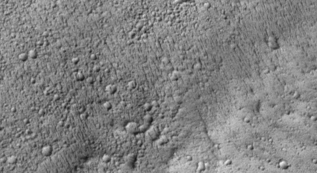 NASA's Mars Global Surveyor shows the contact between the Lycus Sulci uplands and Amazonis Planitia lowlands on Mars.