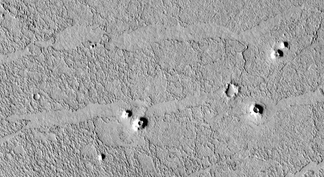 NASA's Mars Global Surveyor shows small cone-shaped structures on lava flows in southern Elysium Planitia, Marte Valles, and northwestern Amazonis Planitia in the northern hemisphere of the red planet Mars.
