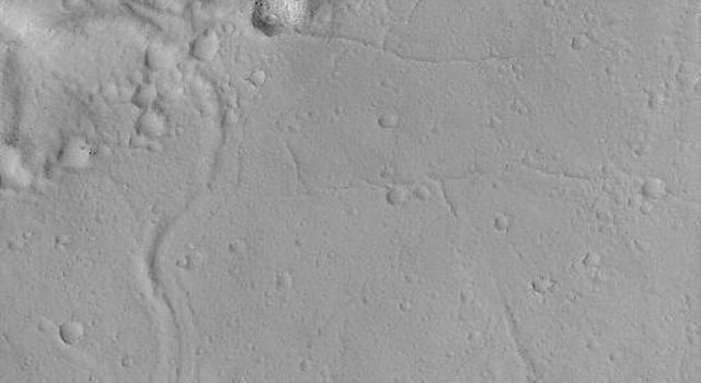 NASA's Mars Global Surveyor shows the summit region of Olympus Mons on Mars including surfaces mantled by fine dust and pocked by small impact craters, and no surfaces exhibit fresh, dark lava flows. Olympus Mons is not an active volcano.