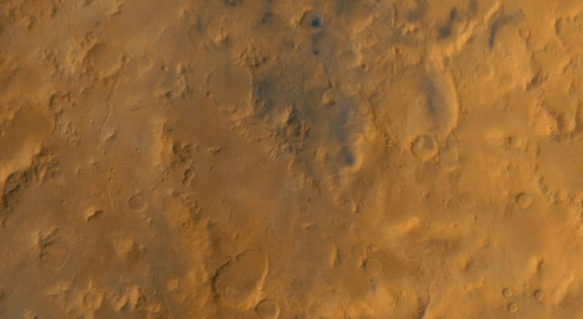 NASA's Mars Global Surveyor shows the Libya Montes, a ring of mountains up-lifted by the giant impact that created the Isidis basin to the north on Mars.