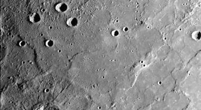This image, from NASA's Mariner 10 spacecraft which launched in 1974, shows young craters superposed on smooth plains. Larger young craters have central peaks, flat floors, terraced walls, and radial ejecta deposits.