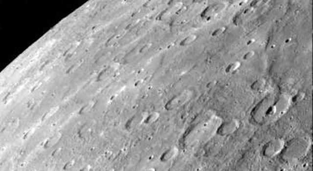 Antoniadi Ridge, over 450 kilometers long, runs along the right side of this acquired image during NASA's Mariner 10's first encounter with Mercury after its launch in 1974.