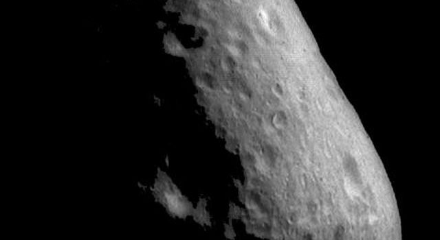 This image from NASA's NEAR Shoemaker shows a cratered region of Eros located at the end of the elongated asteroid. A few of the craters show brightness (albedo) patterns on their walls.