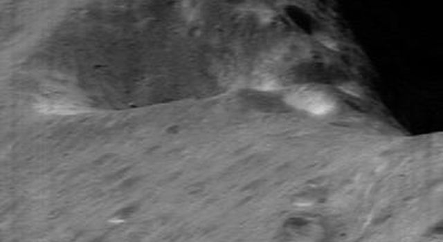 This image taken by NASA's NEAR Shoemaker on April 1, 2000, shows the floor of an impact crater that dominates one face of asteroid Eros.
