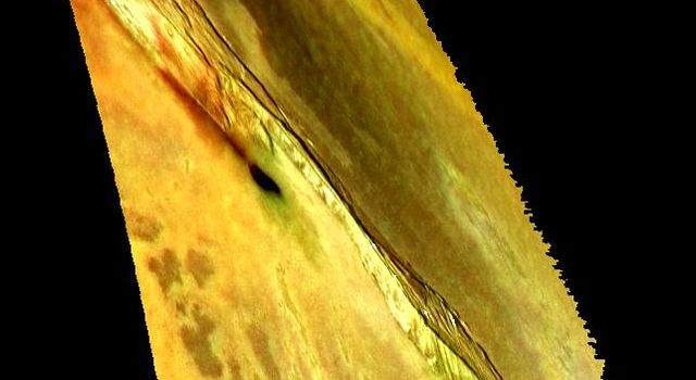 This image from NASA's Galileo spacecraft shows one of many mountains on Jupiter's moon Io. The image was made by combining a recent high-resolution, black and white image with earlier low-resolution color data to provide a high-resolution, color view.