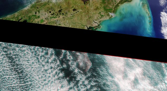 A plume from a large brush fire that burned about 15,000 acres in 2000 is visible at the western edge of the Big Cypress Swamp in southern Florida. NASA's Terra satellite captured acquired this image on April 9, 2000. 3D glasses are necessary.
