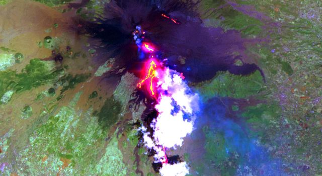 This image, acquired by NASA's Terra satellite on July 29, 2001 shows advancing lava flows on the southern flank of Mt. Etna above the town of Nicolosi.