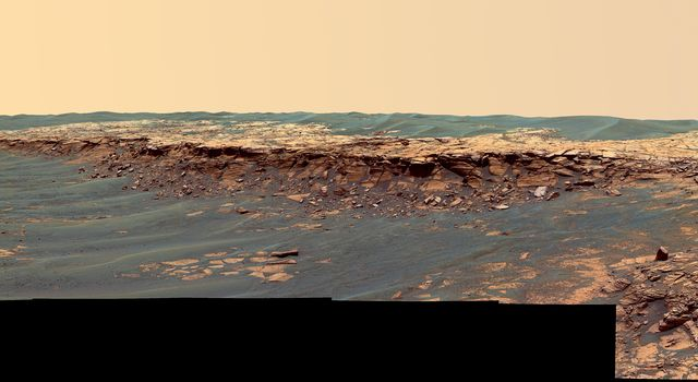 The panoramic camera aboard NASA's Mars Exploration Rover Opportunity acquired this panorama of the 'Payson' outcrop on the western edge of 'Erebus' Crater during Opportunity's sol 744 (Feb. 26, 2006).