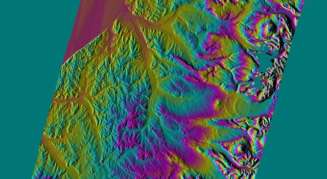 This shaded relief topographic acquired by NASA's Shuttle Radar Topography Mission image from data collected on February 12, 2000 shows the western side of the volcanically active Kamchatka Peninsula, Russia.