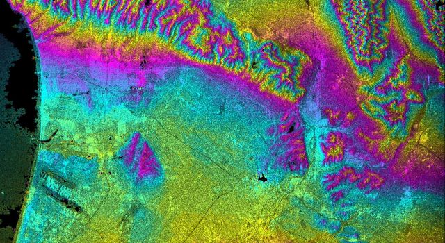 This topographic radar image acquired by NASA's Shuttle Radar Topography Mission in Feb. 2000 shows the relationships of the dense urban development of Los Angeles, Calif. and the natural contours of the land.