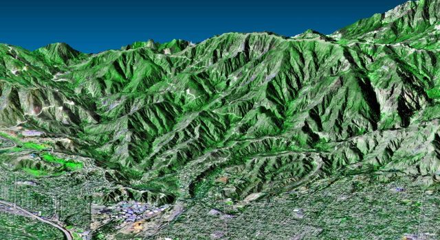 This perspective view, acquired by NASA's Shuttle Radar Topography Mission in Feb. 2000, shows the western part of the city of Pasadena, California, looking north towards the San Gabriel Mountains.