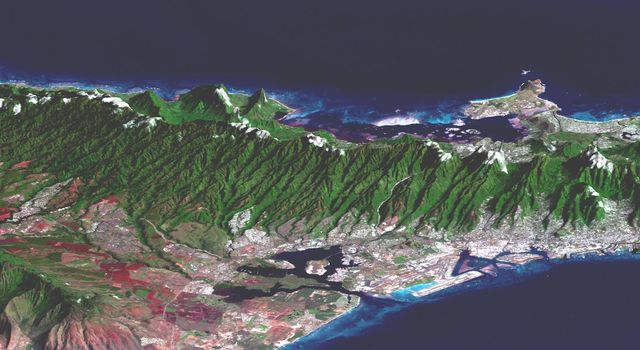 This perspective view, acquired by NASA's Shuttle Radar Topography Mission in Feb. 2000, shows Honolulu, on the island of Oahu.