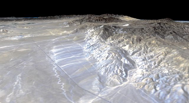California's Garlock Fault, marking the northwestern boundary of the Mojave Desert, lies at the foot of the mountains, running from the lower right to the top center of this image, which was created with data from NASA's shuttle Radar Topography Mission.