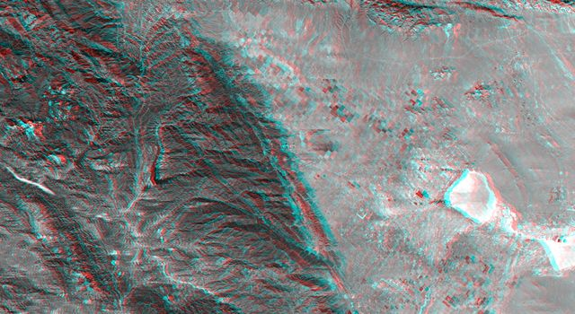 This anaglyph, from NASA's Shuttle Radar Topography Mission, shows rugged terrain between Los Angeles and California's central valley. 3D glasses are necessary to view this image.