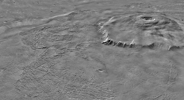 NASA's Mars Global Surveyor shows two views of Olympus Mons on Mars featuring the volcano's scarp and massive aureole deposit that was produced by flank collapse.