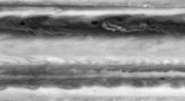 This image is one frame from a movie clip of cloud motions on Jupiter, from the side of the planet opposite to the Great Red Spot. It was taken in the first week of October 2000 by the narrow-angle camera on NASA's Cassini spacecraft,