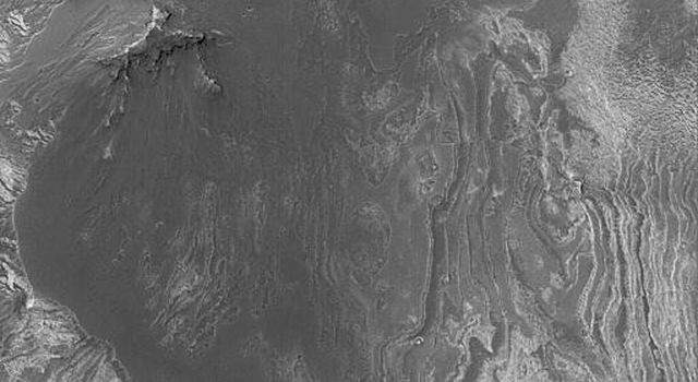 NASA's Mars Global Surveyor shows Valles Marineris, a system of troughs, chasms, and pit chains that stretches more than 4,000 km (2,500 miles) across the martian western hemisphere.