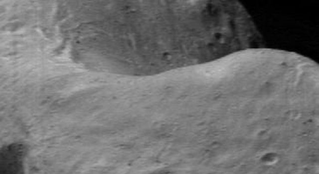 This image of asteroid Eros, taken by NASA's NEAR Shoemaker on March 22, 2000, shows the saddle region, a low ridge connecting two mountains.
