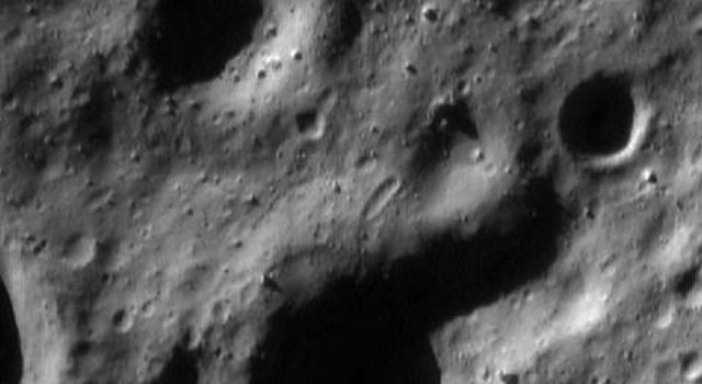 This image of asteroid Eros, taken by NASA's NEAR Shoemaker on May 11, 2000, shows the rounded nature of the landforms resulting from formation of small impact craters over the eons.