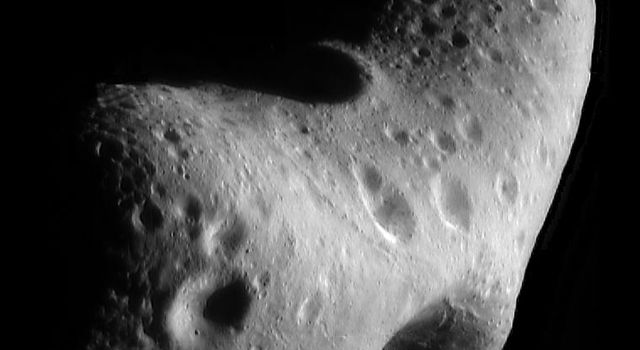 This image of asteroid Eros, taken by NASA's NEAR Shoemaker on Feb. 29, 2000, shows the north polar region highlighting the major physiographic features of the northern hemisphere; the saddle seen at the bottom.