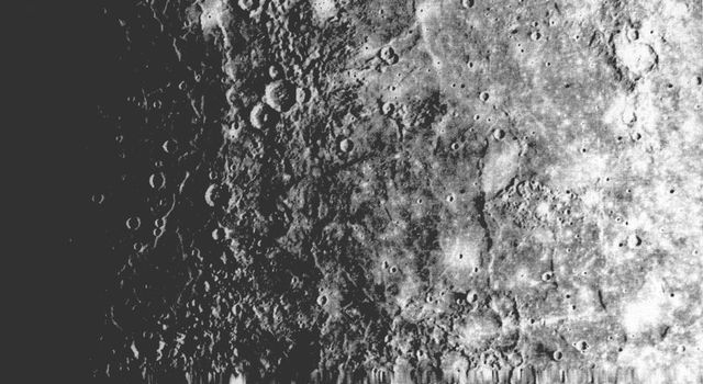 NASA's Mariner 10 shows a close-up view of one-half of a circular basin the largest observed on Mercury. Hills and valleys extend in a radial fashion outward from the main ring.