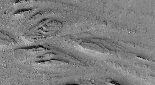 NASA's Mars Global Surveyor shows streamlined landforms carved by catastrophic floods that occurred in the eastern Cerberus region on Mars, some time in the distant martian past.