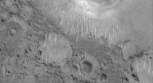 NASA's Mars Global Surveyor shows mesas in northeastern Arabia Terra. This heavily-cratered region of Mars has been severely eroded, although very little evidence regarding the erosive processes has been preserved.