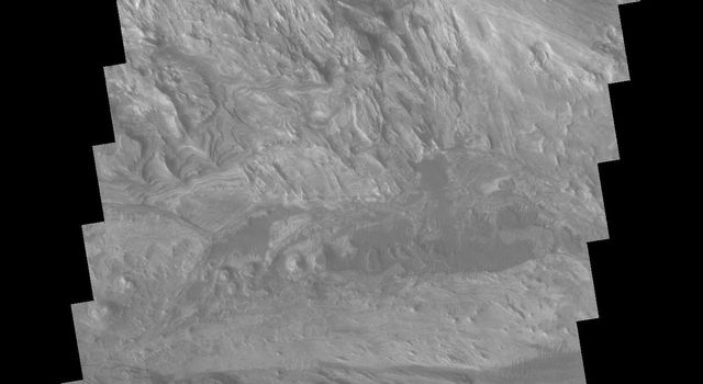 This image from NASA's 2001 Mars Odyssey spacecraft shows part of the layered and wind sculpted deposit that occurs on the floor of Candor Chasma on Mars.